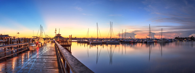 Sunrise over Naples City Dock in Naples, Florida.