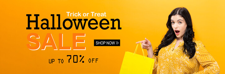 Halloween sale with young woman holding a shopping bag