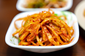 Balloon flower root salad with red chilli is a spicy and salty traditional Korea food. This is a one of famous representative health foods, and this is known to reduce the risk of cancer.