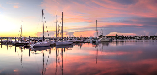 Sunrise over a quiet harbor in old Naples, Florida Wall mural