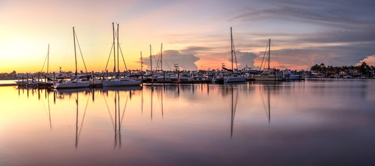 Fotobehang Napels Sunrise over a quiet harbor in old Naples, Florida