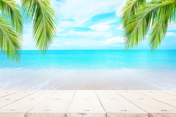 Blue sea background with wood floor foreground for display text or products