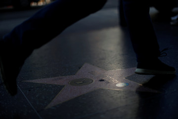 People walk by the Star of actor Bill Cosby on the Walk of Fame in Los Angeles
