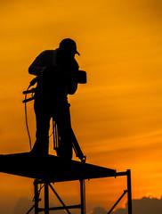Cameraman with sunset