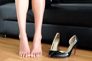 November 5, 2017 at bangkok Studio beautiful woman's legs Her hand catches black high heels wearing. Fashion and health