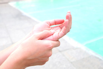 Hand of man pain trigger point with finger lock from office Syndrome. on white background .concept healthy care