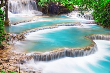 Wall Murals Waterfalls Turquoise water of Kuang Si waterfall