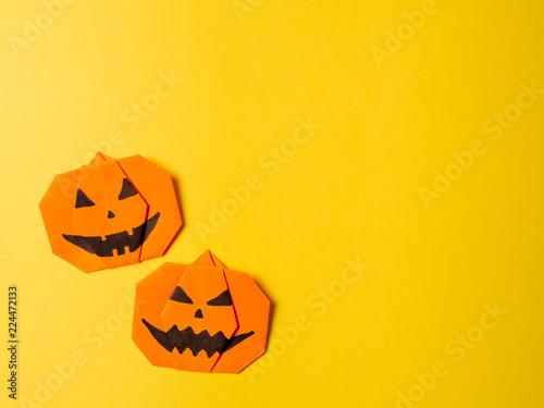Halloween Concept Paper Origami Pumpkin On Yellow Background