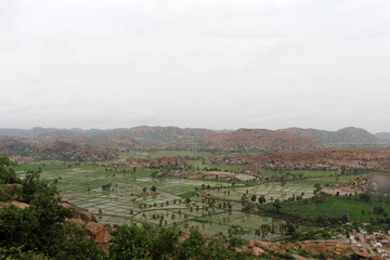 The landscape view or scenery of Hampi, viewed from Anjana mountain (Hanuman Temple) in Anegundi