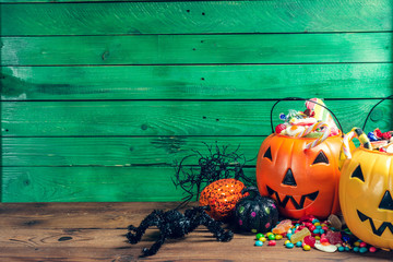 Happy halloween! Pumpkin with candy in the home.