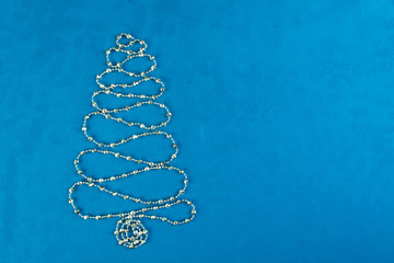 Christmas decoration tree of silver shine garland