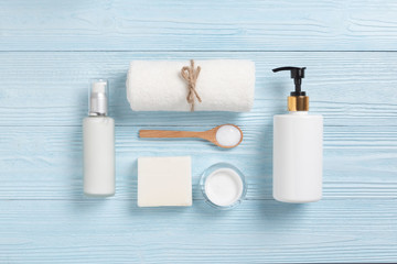 Top view of Cosmetic Spa products on blue wood background.