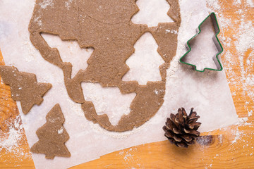 Making cookies in shape of Christmas tree