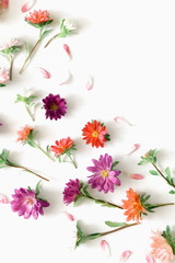 Flowers composition. Pattern made of fall flowers on white background. Autumn flowers concept. Flat lay, top view, copy space