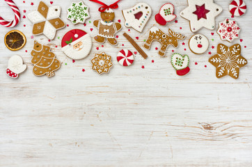 Christmas gingerbread and sweets on wooden background with copy space