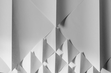White paper folded into square and triangular shapes