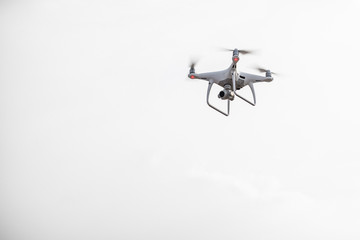 UAV drone copter flying with digital camera.Drone with high resolution digital camera. Flying camera take a photo and video.The drone with professional camera takes pictures of the misty m