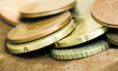Close-up of money euro cent coins in a brown leather wallet
