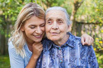 Woman embracing grandma