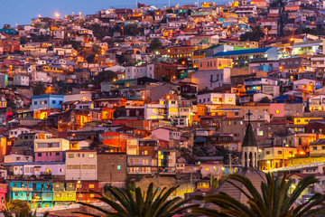 Colorful houses illuminated at night on a hill of Valparaiso, Chile