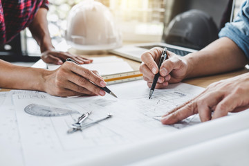 Construction and structure concept of Engineer or architect meeting for project working with partner and engineering tools on model building and blueprint in working site