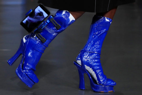 A model presents a shoes creation by British designer John Galliano as part of his Spring/Summer 2019 women's ready-to-wear collection show for Maison Margiela fashion house during Paris Fashion Week in Paris