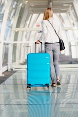 Woman with her baggage on airport terminal