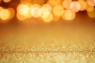 Blurred golden glitter lights as background, wallpaper or texture for Christmas and Holidays