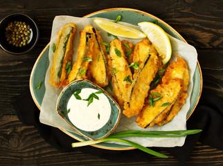 Eggplants and zucchini fried in tempura.