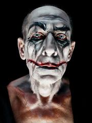 Bloody Halloween theme: The crazy maniak face on dark studio background