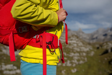 Pretty, young female hiker walking in high mountains (shallow DOF)