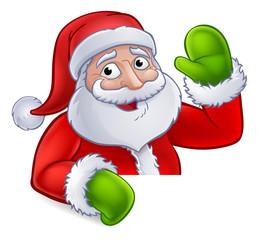 Santa Claus Christmas cartoon character above a sign waving