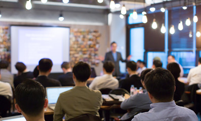 Business People Meeting and Working while Business Executive Lead Presenter Speaks to Group of Successful Technology Entrepreneurs. Consultant Advisor. Growth Training Lecture. Defocused Blurred Wall mural
