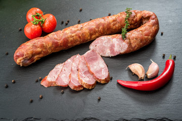 Selection of different types of salami. Organic products on a wooden table