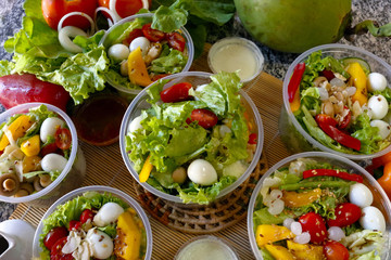 Fresh vegetable salad in an open plastic bowl packing