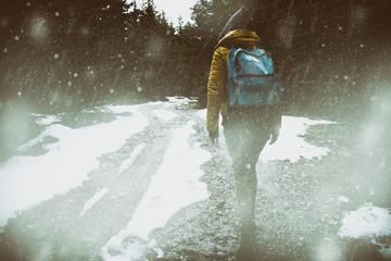 Girl hiking through a rough terrain in winter / autumn time.