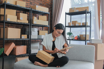 Portrait of asian businesswoman call with smartphone work at hom