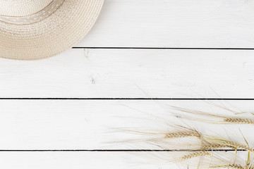 Farmhouse vintage table with straw hat and spikelets of wheat. Autumn, summer top view with copy space. Flat lay for lettering, text, blogs, magazines, headers, freelanse
