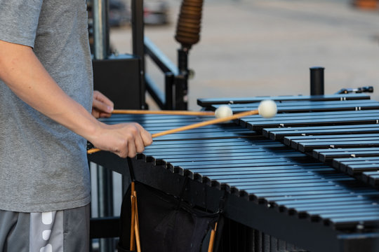 sideline percussionist rehearsing on his vibraphone at marching band rehearsal