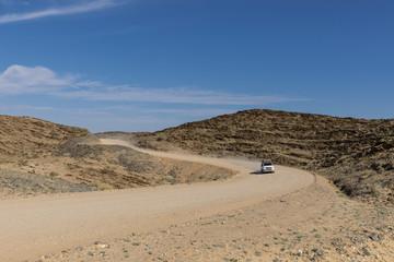 Africa, Namibia, Namib desert, Naukluft National Park, off-road vehicle on gravel road