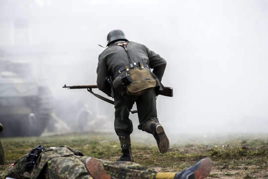 Historical reenactment of soldiers during the Second World War, view from the back
