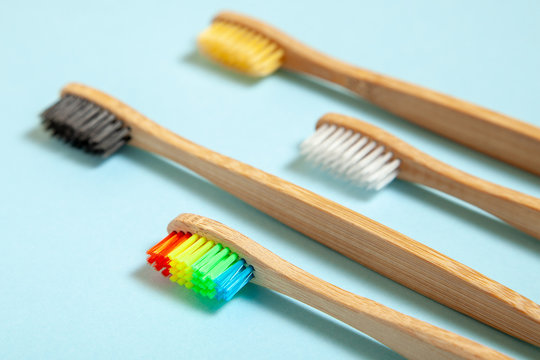 Set of toothbrushes on blue background. Concept toothbrush selection, bamboo eco-friendly