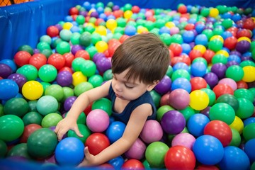 Cute baby boy toddler - in the ball pool
