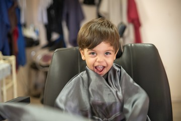 Cute baby boy toddler - cutting hair.