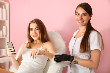 Master cleanse hands with napkin before procedure. Concept hair removal.