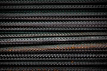 Black metal rods for reinforcement concrete building construction close up.