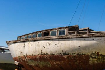 Cherbourg, France - 2018. Old rusty boat waiting for dry dock.