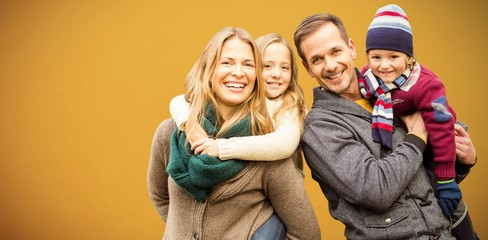 Composite image of portrait of family smiling together