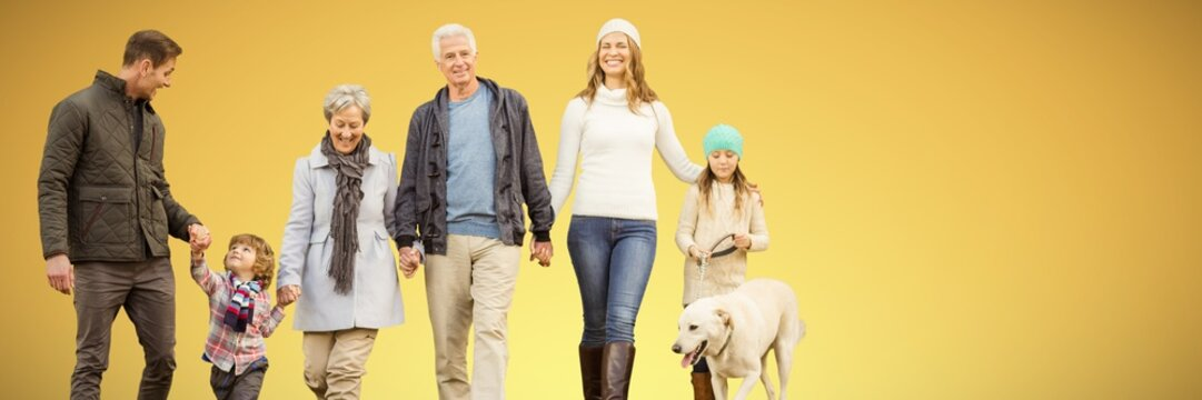 Composite image of happy family walking with their dog