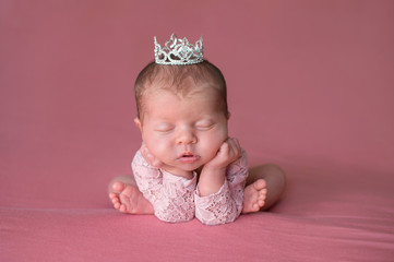 Sleeping Newborn Baby Girl Wearing a Tiara